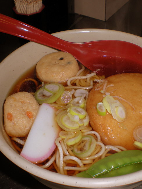 soba noodle soup with vegetables and fish cakes